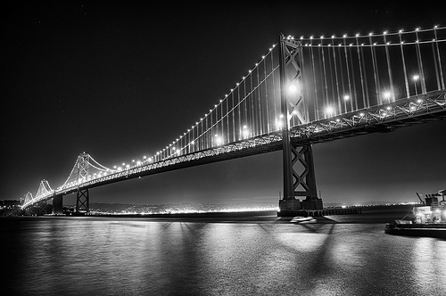 Moon Captured by the Bay Bridge - Black & White by Harold Davis